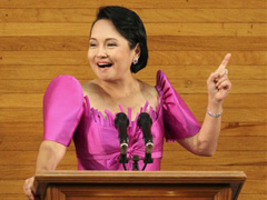 Mrs. Gloria Macapagal Arroyo (in a fuschia-colored terno designed by Inno Sotto) delivering a rancorous SONA.