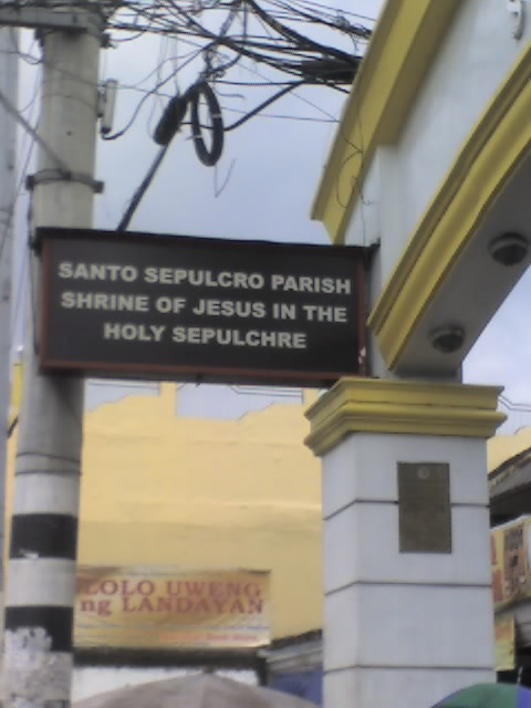 The name of the church posted beside the arch.