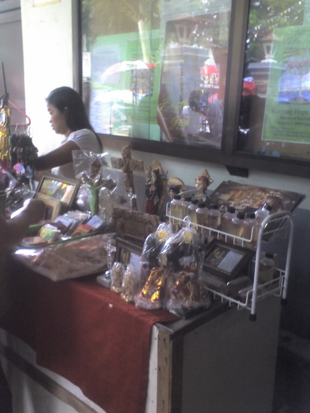 Religious items for sale (at right is Kuya Sonny's book about Lolo Uweng and his church).