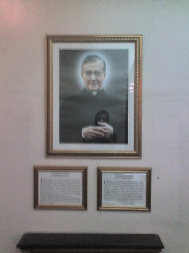 A frame of Fr. José María Escrivá which hangs on the hall leading to Lolo Uweng.