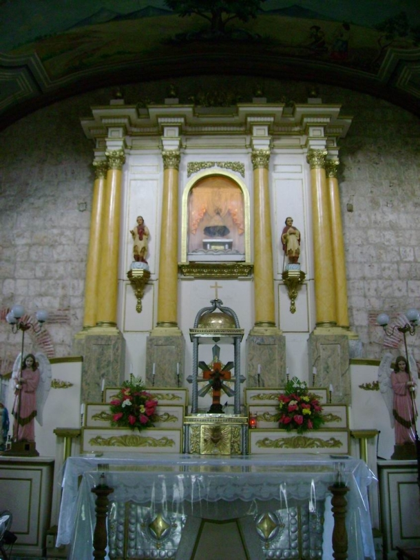 The simply-designed retablo of the centuries-old Church of Caysasay.