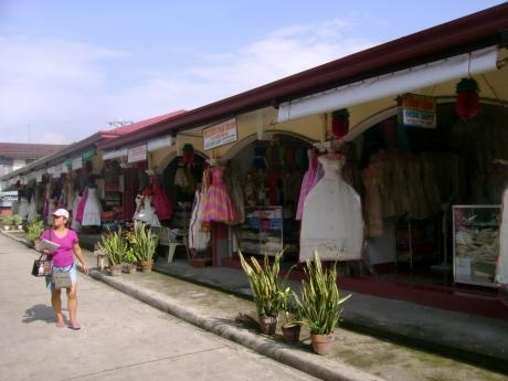 A row of Barong Tagalog stalls at the public market.