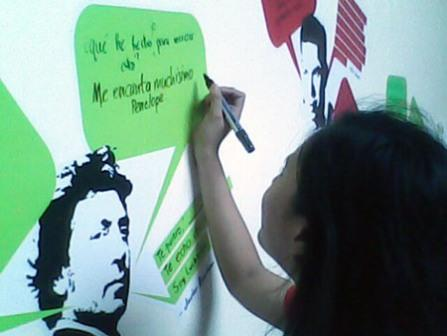 A young lady scribbles a comment in Spanish on a message wall at Instituto Cervantes to mark José Rizal's 150th birthday (Earl Rosero of GMA News).